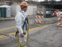 Worker wearing personal air monitor for lead exposure in preparation of Railroad and Highway Bridge modifications 2015